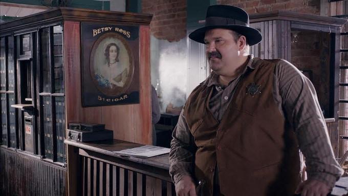 "MEL RODRIGUEZ as ""Sheriff Dandy"""