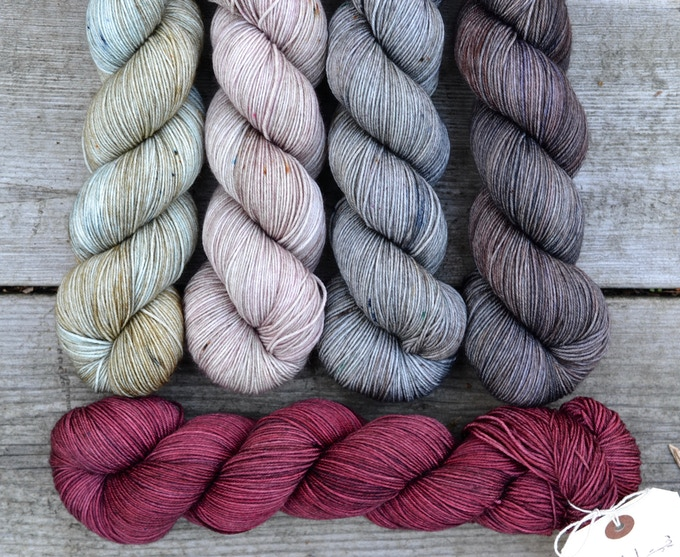 from left to right, Dew Drop, Wild Rose, Pebble, Winterwood. Bottom, Black Lodge. Shown in Viola Sock