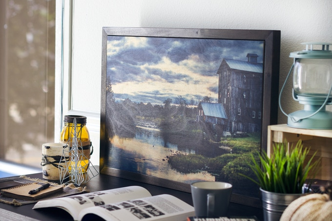 """A signed print on wood, the """"Ol' Millhouse"""" landscape photograph at 20"""" by 30"""", crafted sustainably with a hand-stained framed and ready to hang."""