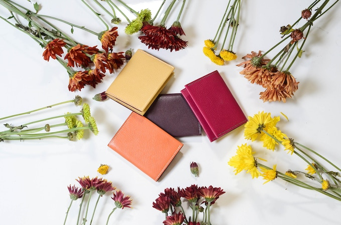Card wallets in yellow, magenta and orange