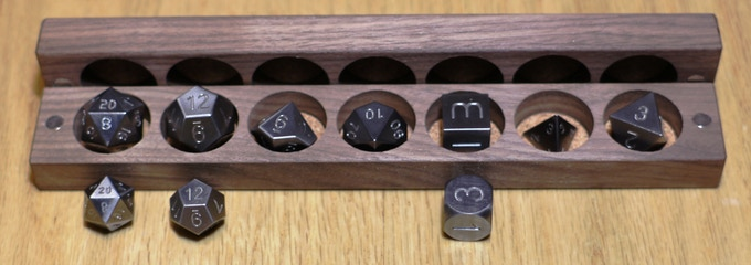The dice IN the Dice Base One holder are the ones that are default. You cannot choose the smaller versions of the D20 or 12 but you can choose round or square corners on you D6
