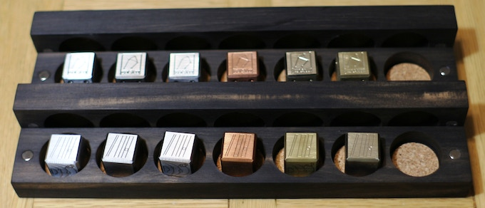 Zucati Logo Dice seen here with The Pale Blue Die metal Collector's set.