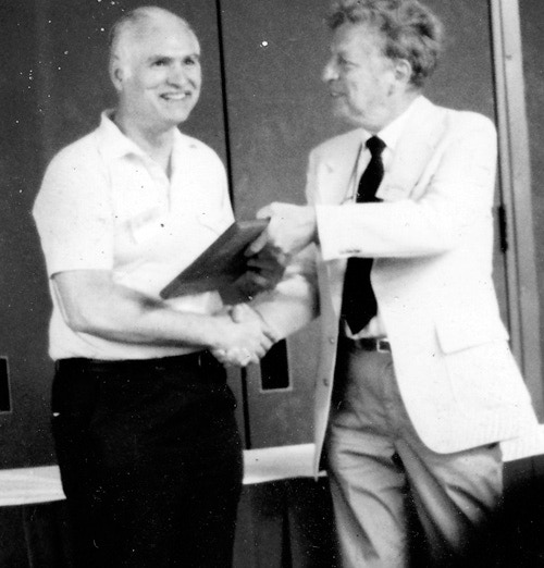 Lou Zocchi being inducted into the Adventure Gaming Hall of Fame at Origins in July 1987. Presenting the award is Charles Roberts, founder of Avalon Hill.