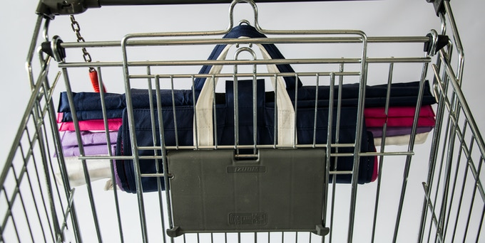 Neatly hangs on your trolley.