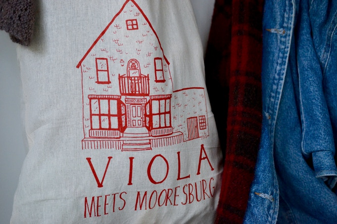 RED tote with illustration of the store
