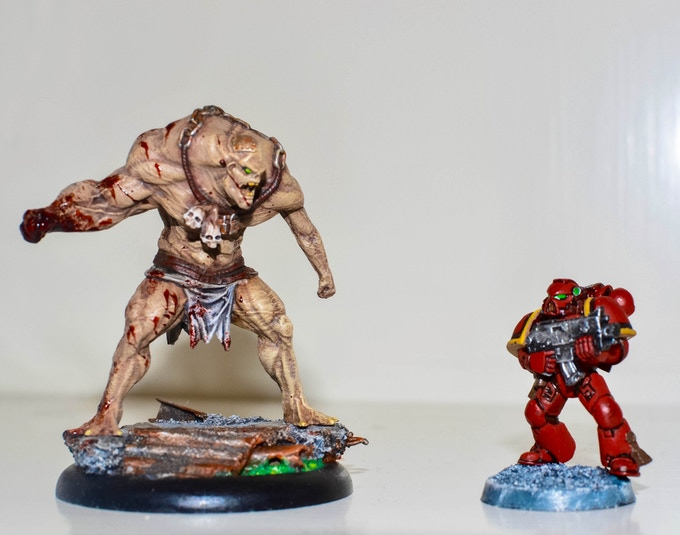 The Unstable Abomination next to a Games Workshop Space Marine