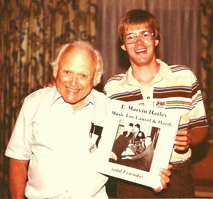 """Author Randy Skretvedt with """"Ku-Ku"""" theme song composer T. Marvin Hatley, showing off their 1982 album"""