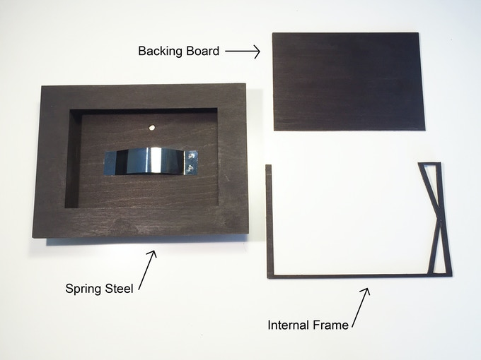 [image of components including spring steel, stained black internal frame and backing board]
