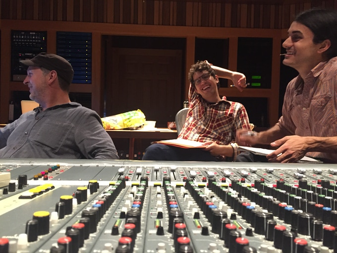 Erick (L), Christian (C), and Ethan (R) behind the console giving a listen.