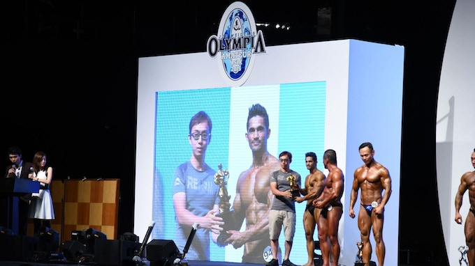 Rick hands out more awards while REARM was nominated as the best designed sport outfit in the Olympia Asia 2015 contest.