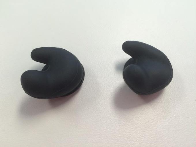 Left: soft, flexible pre-mold. Right: solid custom mold of Dan's ear.