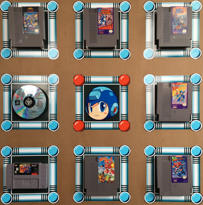 Megaman 1 - 8, mounted directly on a wall