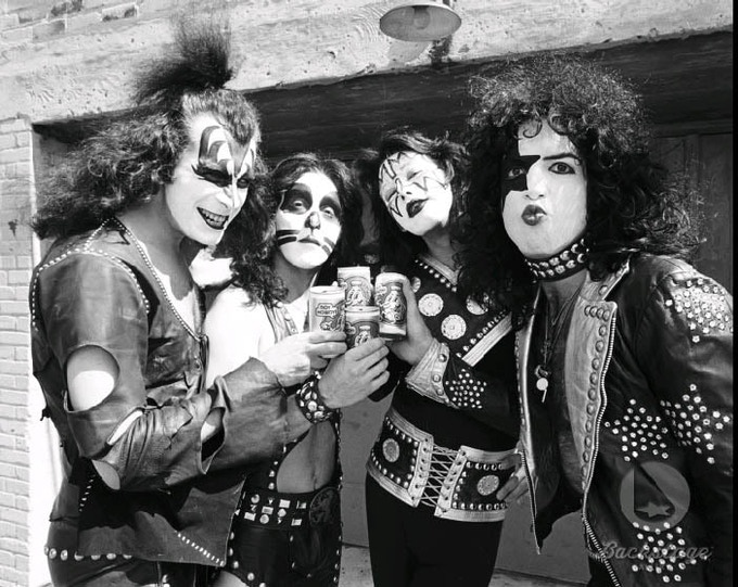 "KISS holding up the iconic ""Boy Howdy"" beer, 1976"