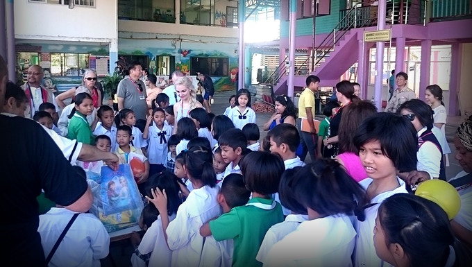 Jenna posing as the Ice Queen to bring underprivileged kids in Thailand school supplies