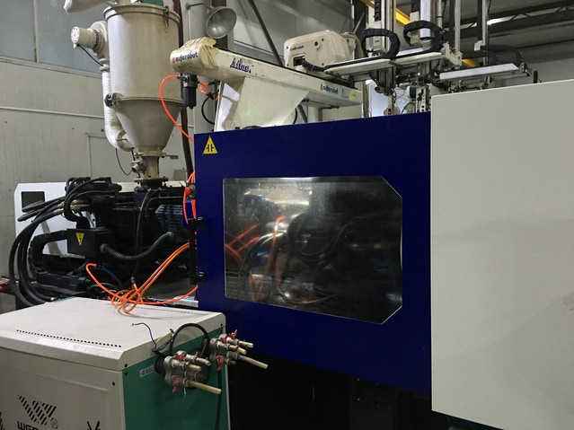Close up of one of the plastic injection machines