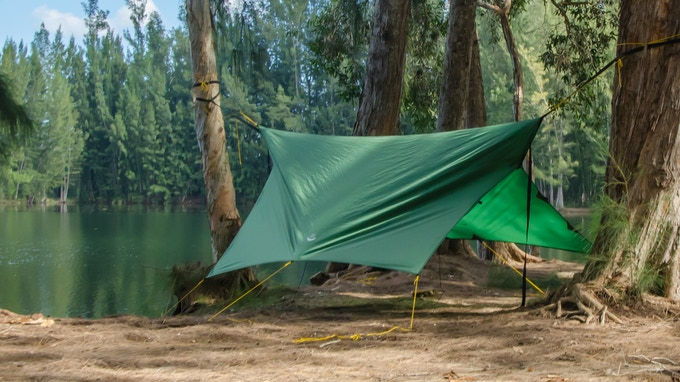 Storm Mode with Partially Closed Ends: The short panel tie out points allow the tarp to be partially closed to add extra weather protection at the ends of the hammock.