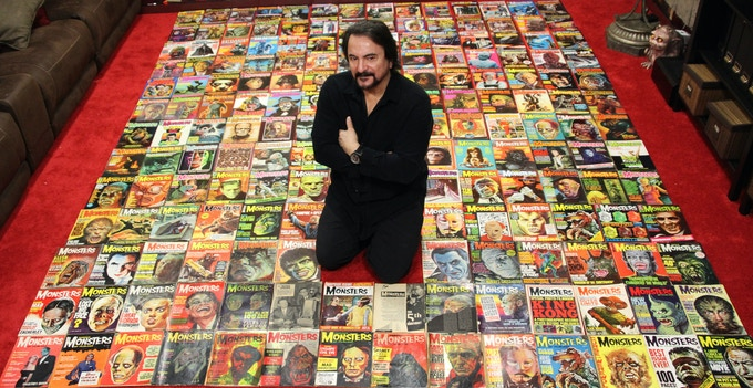 Tom Savini with his complete Famous Monsters collection.