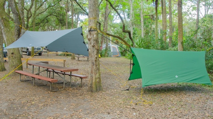 The Apex is available in Forest Green and Slate Gray. In this photo Slate Gray tarp is pitched in a general camping/shade canopy mode and Forest Green tarp is pitched in storm mode.