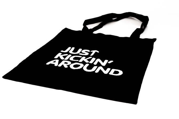 """Our tote bag. Made from cotton. Raised ink. With a """"tread"""" pattern in the letters."""