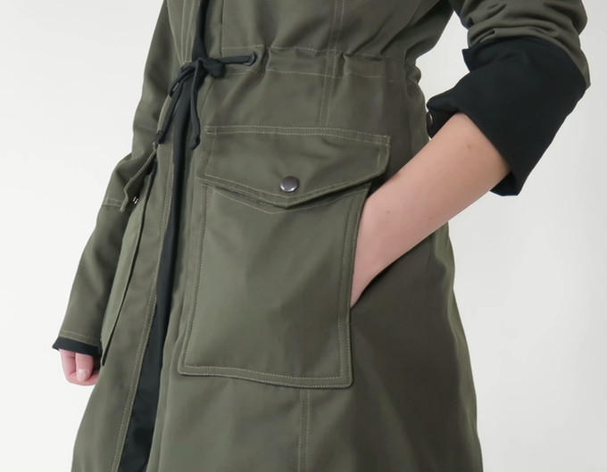 Sleeves can be rolled up and snapped in place. Pockets are lined with fleece to keep hands warm.