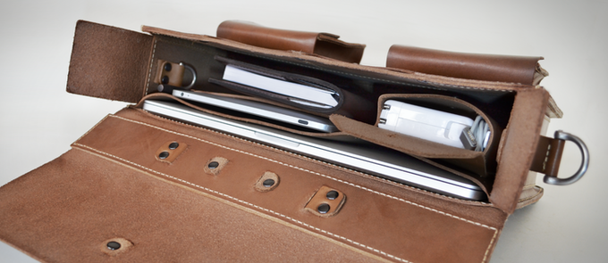 """Pen, 15"""" MacBook Pro, iPad, Apple charger and our A5 notebook in a three inch """"slim"""" briefcase."""