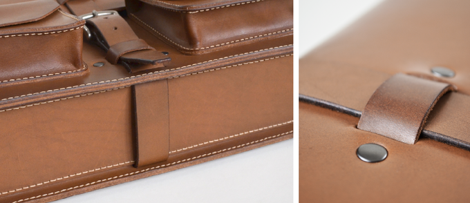 Full wrap-around straps support the briefcase from below and help the bag retain its shape. Riveting the belt loops from behind does not pull on the rivet caps or stretch out the leather.