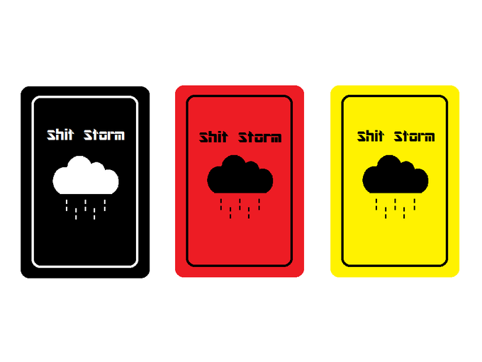 A demo deck of Shitstorm cards. Black pile, Red pile, Gold Pile.