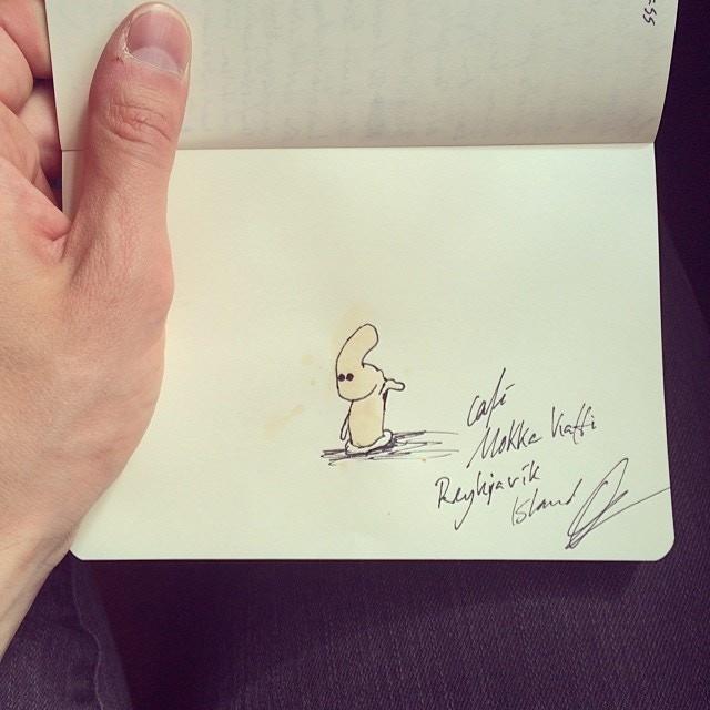 Drawing monsters in my notebook in Reykjavik, Iceland.