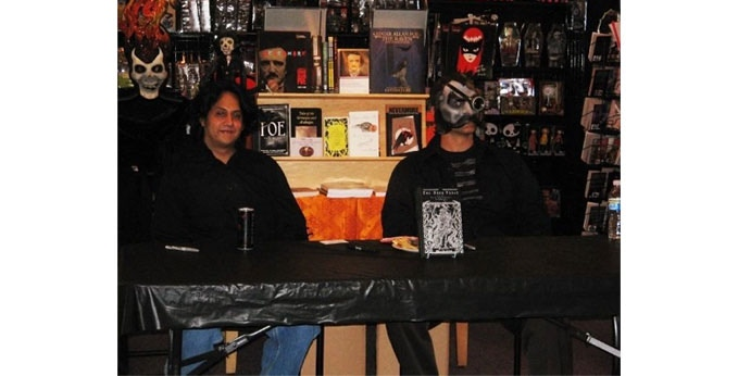 Here is a picture of John F. Stifter (the master behind all of The Dark Verse's artwork thus far) and I at a book signing at Dark Delicacies in Burbank, CA on September 22, 2009.