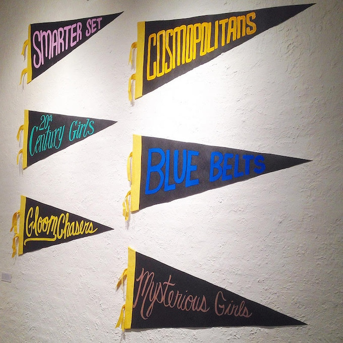 Pennants honoring turn-of-the-century women's basketball teams by Maria Molteni