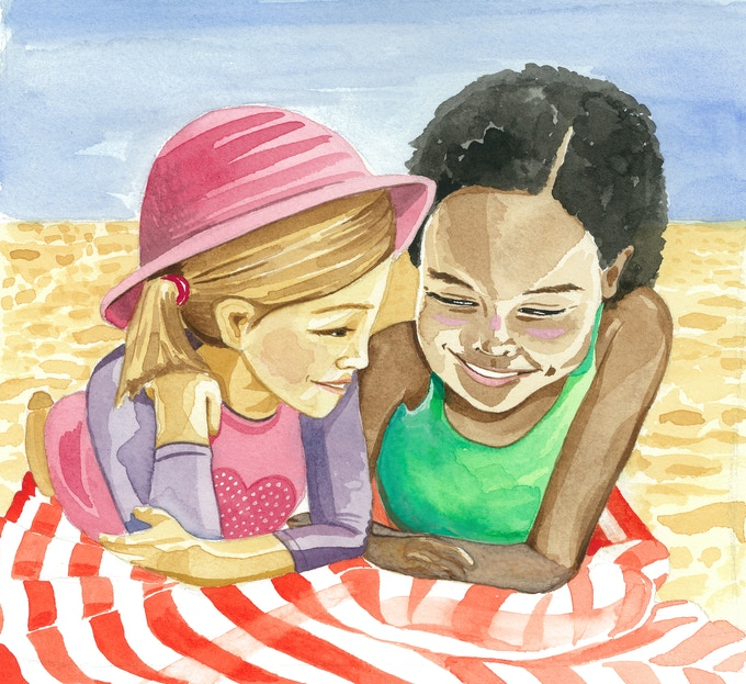 Sunny and Isla relax on a beach blanket.