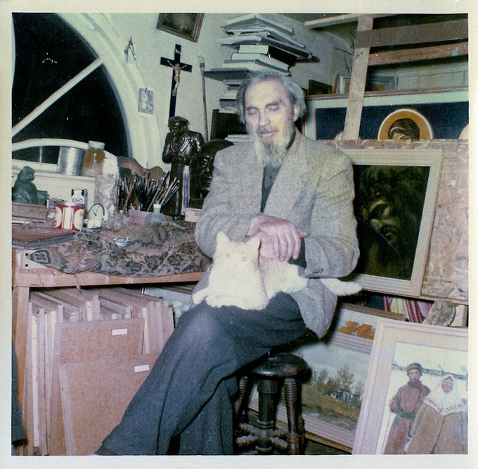 Mitrofan Kossenko and his cat in their studio residence in the Orthodox church attic, North Edmonton