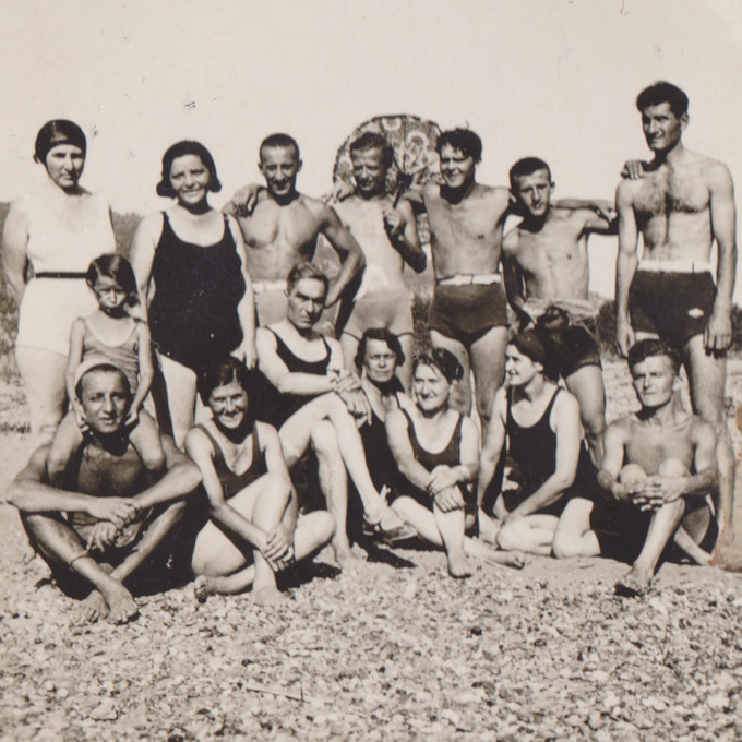 Kossenko scowling in the sun at a 1936 beach party