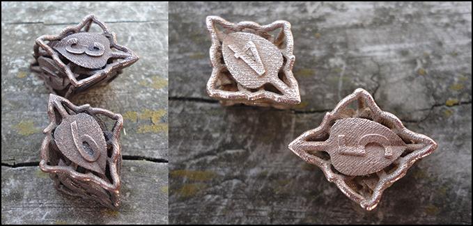 Rhombic botanical d6s in bronze steel (left) and steel