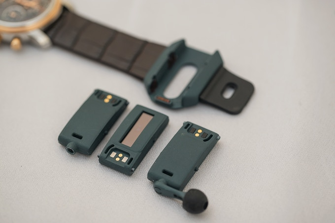 Prototype HOT Band shown with Audio Fob, Smart Fob, and Audio Fob w/detachable earpiece (left to right)