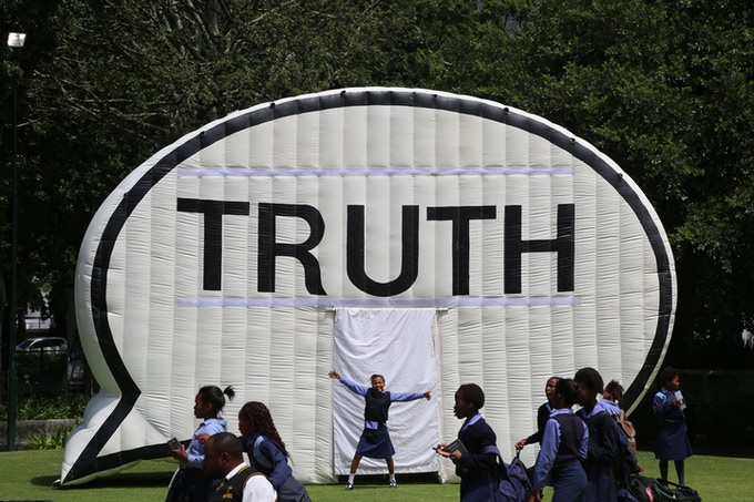Students visited the Truth Booth in a park in Cape Town, South Africa in 2014.