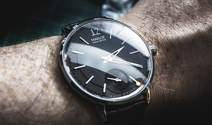 Black dial, polished case with black leather strap