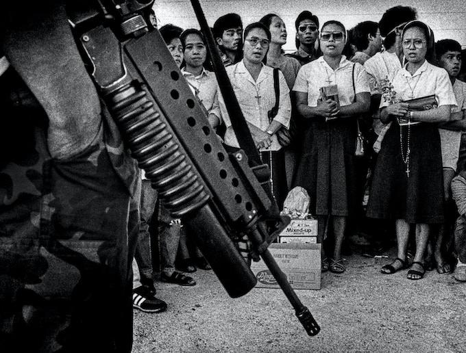 "Nuns face Marcos marines, ""Camp Ortigas"", Manila, Feb. 23, 1986"