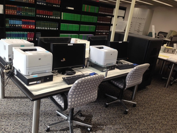 CIA's declassified records database (right) and the only four computers that can access it (left).