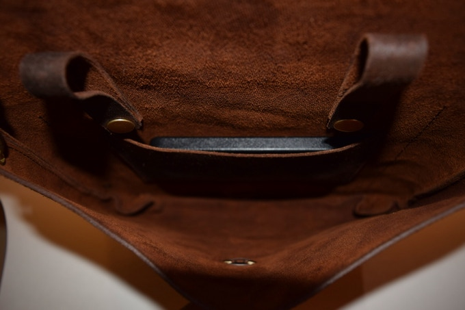 Inside phone pocket. No lining to showcase beauty of leather.
