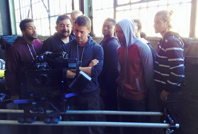 Director and Stunt Team reviewing the footage