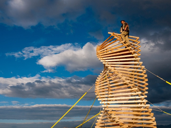 Helix Spire is a sculptural play toy, a climbing tower and a lookout 25 feet above the playa at this years Burning Man festival.