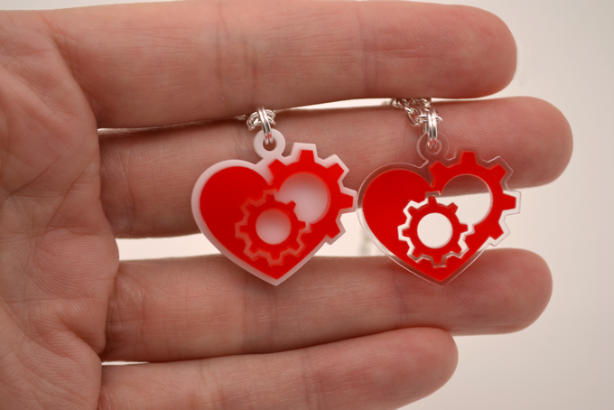 """A close-up of the empowering """"heart gear"""" necklace."""