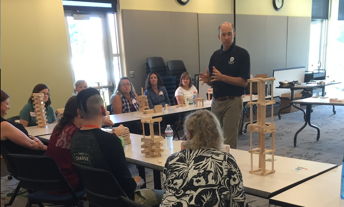 Ken leads a class for teachers, introducing ways of integrating block play activities into their classrooms.