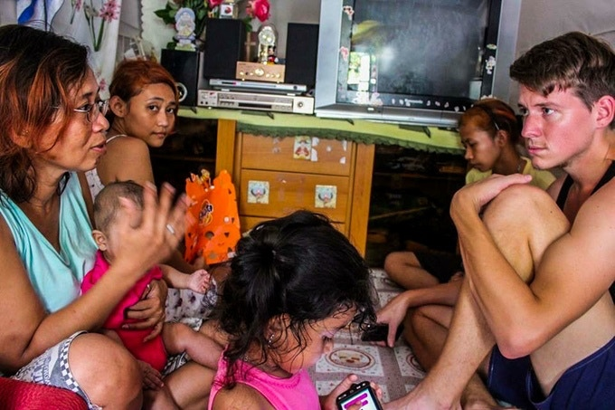 Meeting refugees in an illegal slum controled by the triades in Hong Kong
