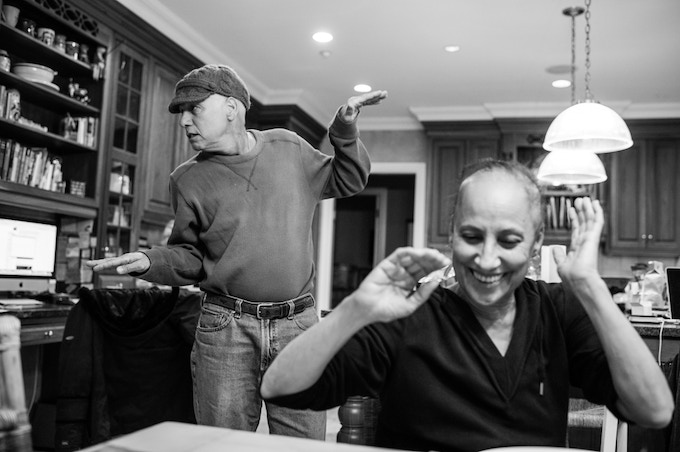 In the kitchen, Howie Borowick breaks into a bouncing dance to hopefully get a smile out of wife, Laurel. They often turned to humor to lighten the heavy mood in the home. Chappaqua, New York. February, 2013.