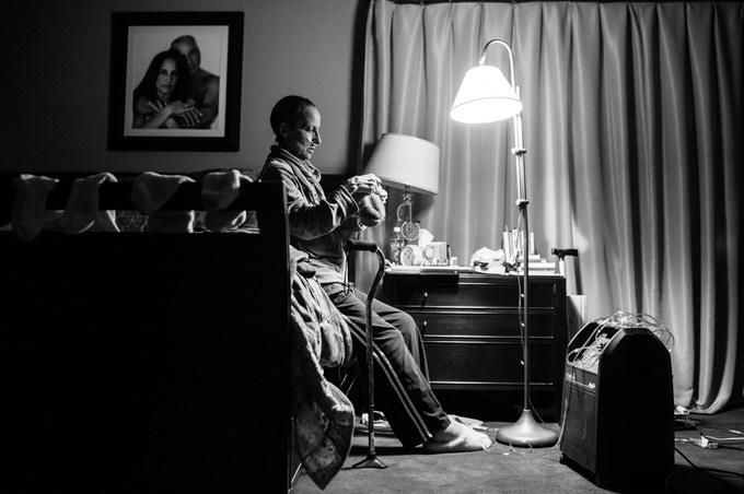 Laurel struggles to breathe with ease as her tumors grow. An oxygen machine is now a permanent fixture in the home and helps her when she feels she needs it. Chappaqua, NY. November 2014.