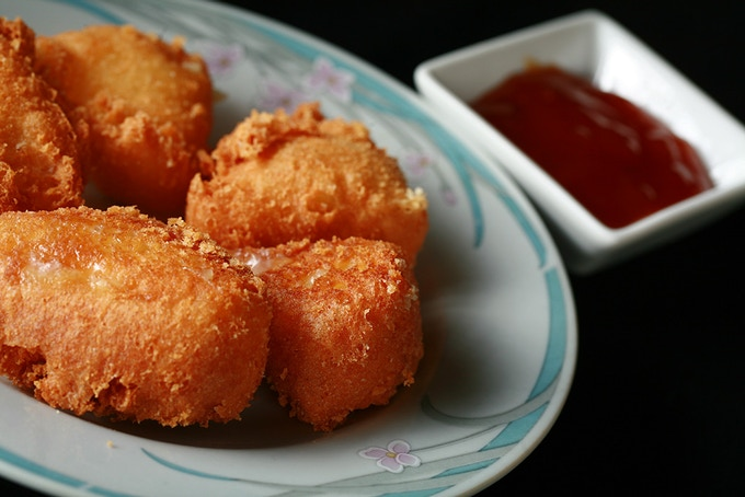 Brie Bites: Bite sized wedges of brie, dipped into a white wine batter.... deep fried and served with apricot preserves. Yes, as ridiculous as it sounds.