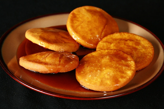 Sopaipillas Pasadas: A pumpkin flavoured fried pastry from South America, served in a slightly spicy caramel sauce that's been flavoured with orange peel.