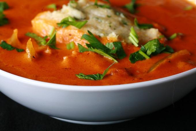 Creamy Shrimp-Andouille Creole soup, with tender, fluffy cornmeal dumplings.